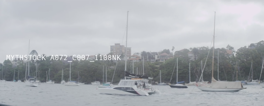 View from on water of boats moored on Sydney Harbour - cloudy day, hand-held