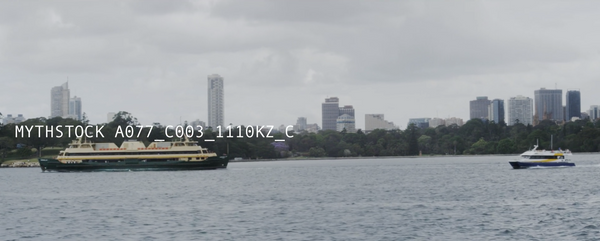 A ferry glides across Sydney Harbour in front of the CBD foreshore (Part 3) - hand-held shot