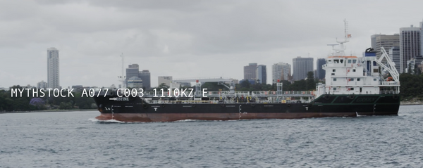 A huge tanker chugs across Sydney Harbour, POV from the water, hand-held shot