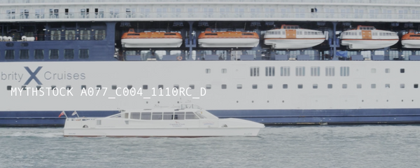 A massive cruise liner, POV from the water, hand-held shot - 4K anamorphic