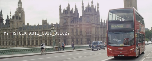 The Houses of Parliament with double decker buses during the day