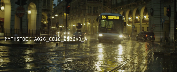 Twilight rain-soaked streets in Europe with classical archways, a bus and tram tracks (Part 3)