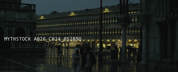 Tourists wander in the Piazza San Marco, Venice at dusk