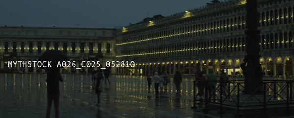 Tourists wander in the Piazza San Marco at dusk