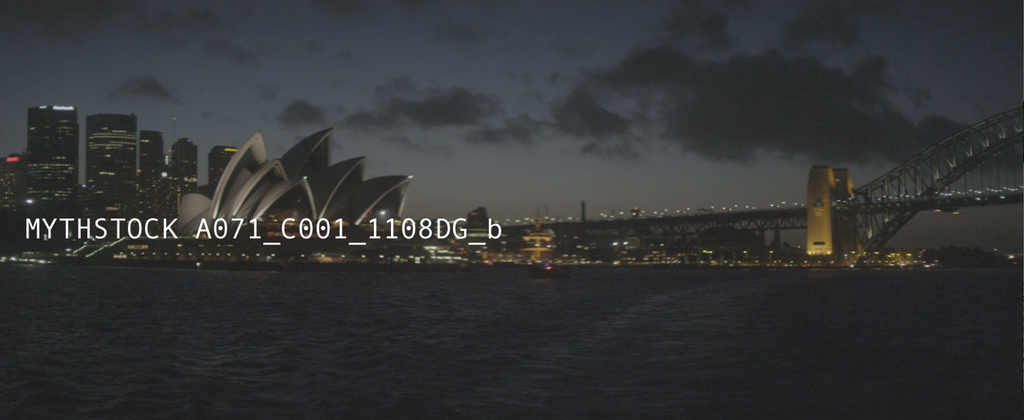 Stunning view of Sydney Harbour Bridge and Opera House after sunset - hand-held on water (Part 2)