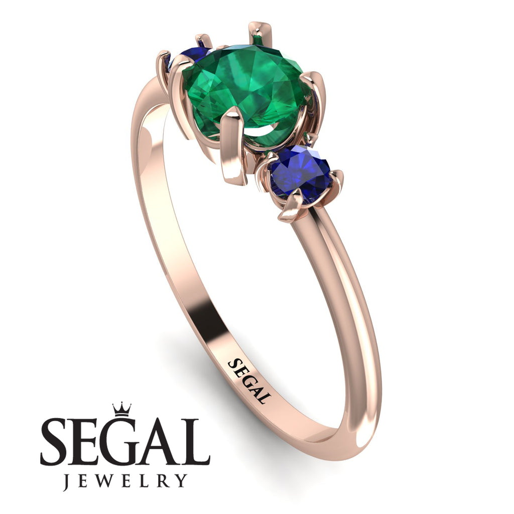 Classic_three_stone_Emerald_engagement_Ring_1.jpg