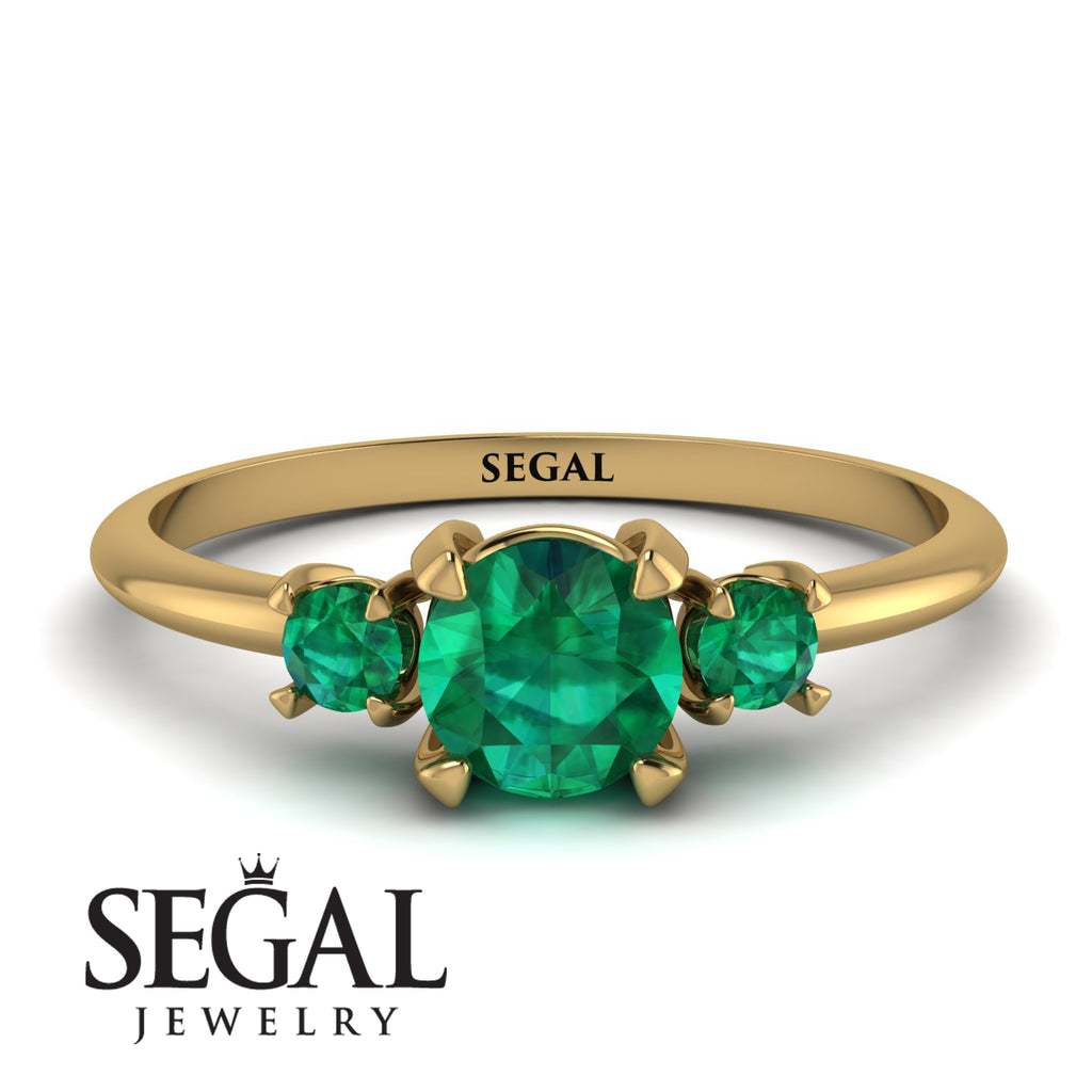 Classic_three_stone_Emerald_engagement_Ring_2.jpg