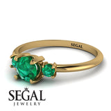 Classic_three_stone_Emerald_engagement_Ring_3.jpg