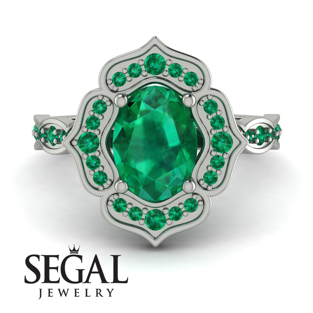 decorated_halo_Oval_Emerald_engagement_Ring_2.jpg