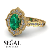 decorated_halo_Oval_Emerald_engagement_Ring_3.jpg
