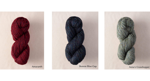 The Woolly Thistle Peace Fleece worsted weight in Amaranth (red), Bonnie Blue Gap (blue), and Anna's Grasshopper (green)