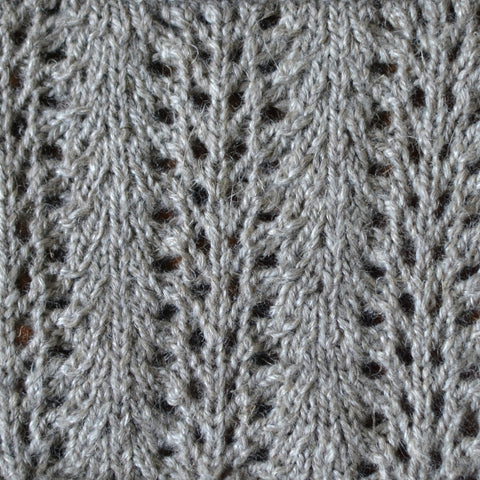 A swatch of lace knitting knit with Blacker Lyonesse.