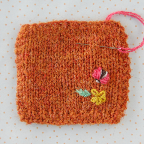 Little knit square with embroidery in progress