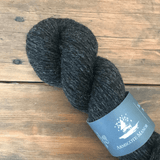 Skein of Armscote Manor's Black Welsh Mountain wool, a black colored, DK yarn.