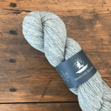 Skein of Armscote Manor's Portland Wool with a dash of Black Welsh Mountain wool, a light gray color, DK yarn.