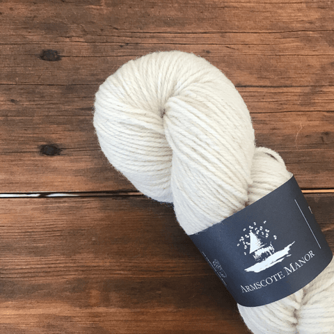 Skein of Armscote Manor's Portland wool,  a white colored, DK yarn.
