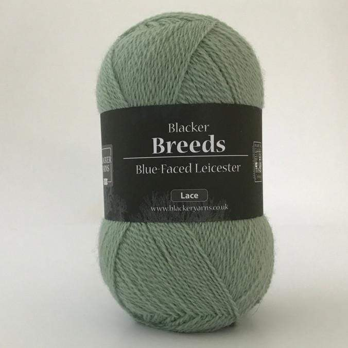 Ball of Blacker Blue-Faced Leicester 2-ply Lace Yarn in colorway Moonlight Gourami, a dusty blue green color.
