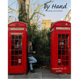 Cover of By Hand Lookbook No. 12: London with woman leaning against a red telephone booth.