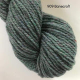 Skein of Harrisville Designs WATERshed worsted weight yarn in colorway 909, Banecroft, a tweedy shade of blue-gray.