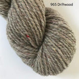 Skein of Harrisville Designs WATERshed worsted weight yarn in colorway 965, Driftwood, a tweedy shade of gray.