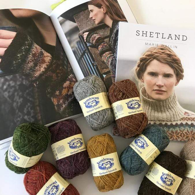 Jamieson Spindrift Yarn with the Shetland book by Marie Wallin open to the image of the Skerries Mittens.