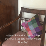 Mitered Square Patchwork Pillow made with Jamieson & Smith 2 ply Jumper Weight Yarn grab bag.