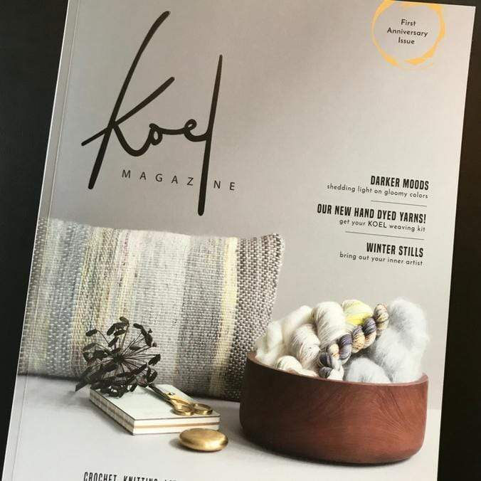Cover of Koel Magazine featuring a bowl of yarn and roving and a woven pillow artfully arranged.
