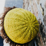 Model wearing a chartreuse knit cap.