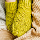 Chartreuse knit slippers.