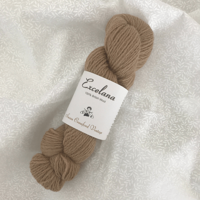 Skein of Excelana 4ply by Susan Crawford Vintage Yarn in colorway Polypore, a brown color.