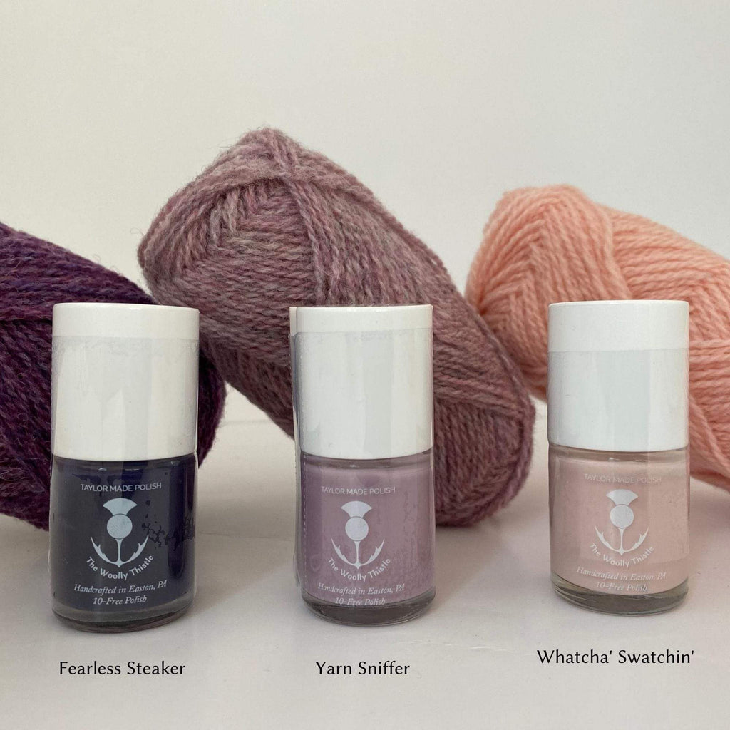 Knitters Nail Polish by The Woolly Thistle Flagship colors: Fearless Steaker (deep purple), Yarn Sniffer (pale purple) and Watcha' Swatchin' (peach).
