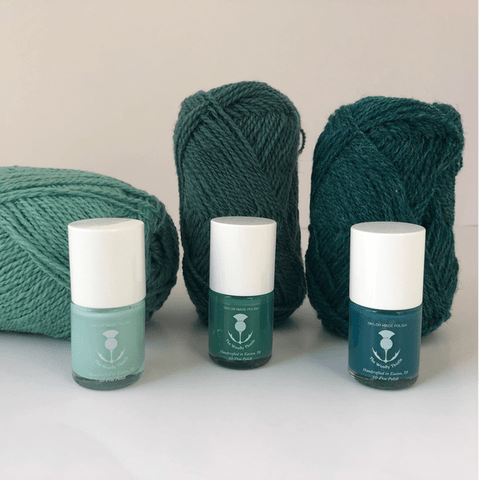Three lovely green nail polishes. 'Yarn Snob' is a light pale green, 'Frog It' is a full bodied mid-green, and 'Castonitis' is a dark greeny-blue.