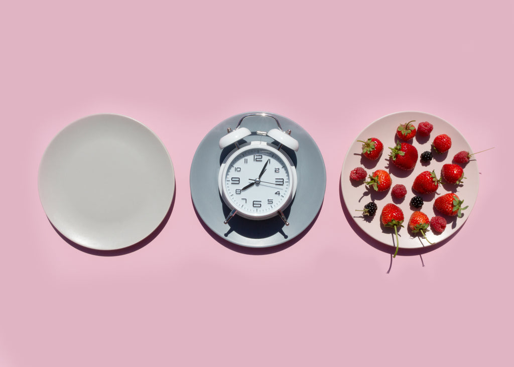 clock and strawberries on plates