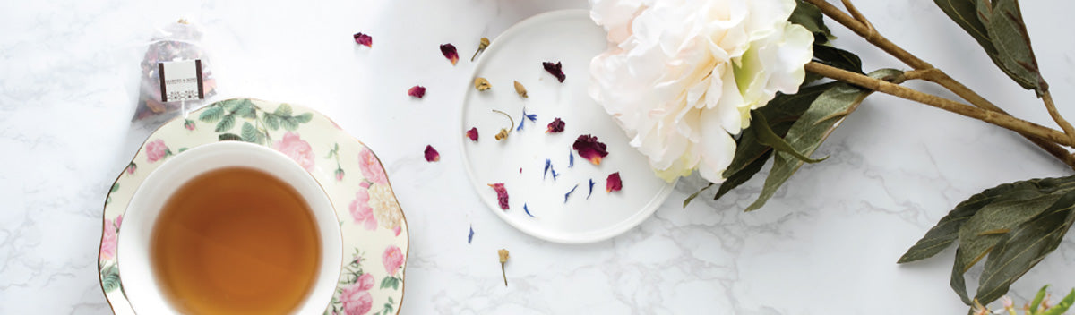 tea cup and white flower