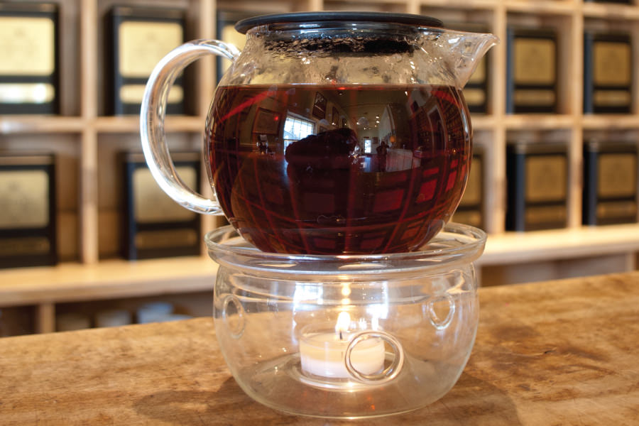 a glass tea kettle full of brewed herbal tea