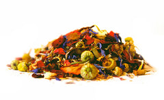 a colorful pile of loose herbal tea with a blend of dried fruit, flowers, and herbs
