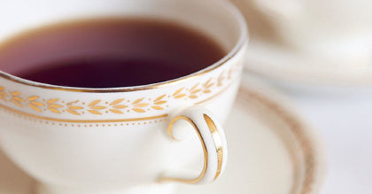fine china cup with brewed tea