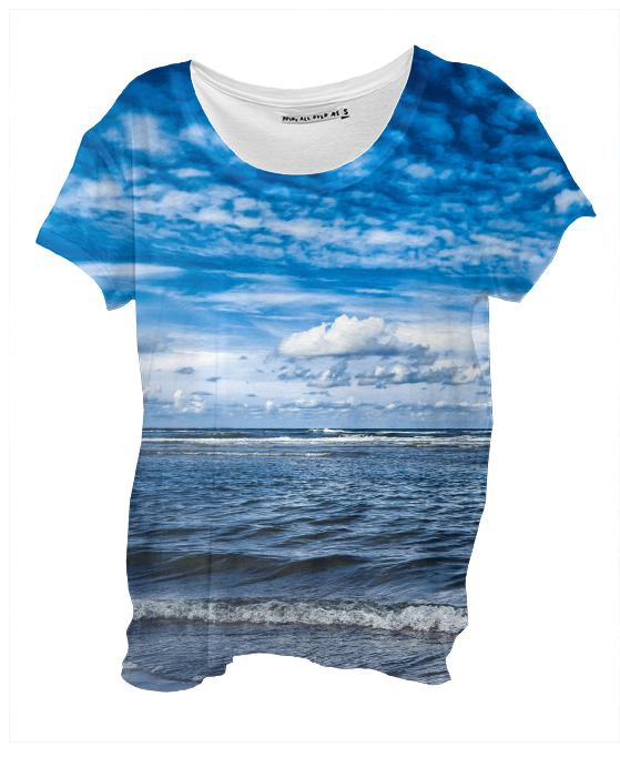 Cloudy day on the beach Drape Shirt