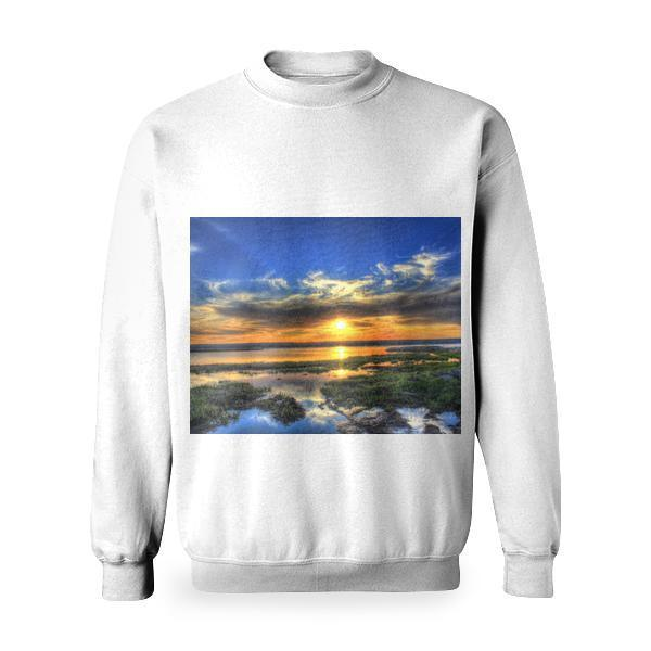 Green Grass Near Body Of Water Under Gray Cloudy Sky During Sunrise Basic Sweatshirt
