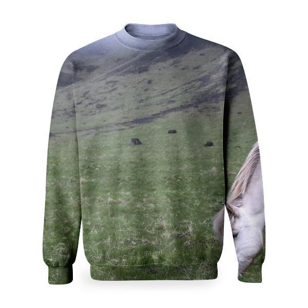 White Horse Eating Grass Near A Green And Black Rocky Formation With Fog Basic Sweatshirt