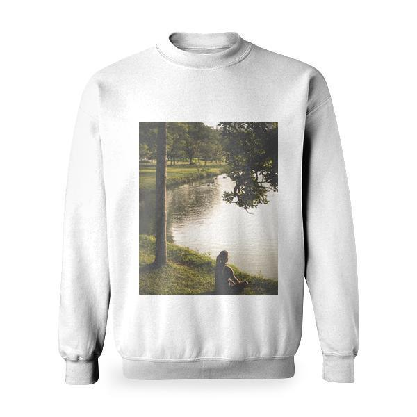 Woman Sitting On Grass By Lake Basic Sweatshirt
