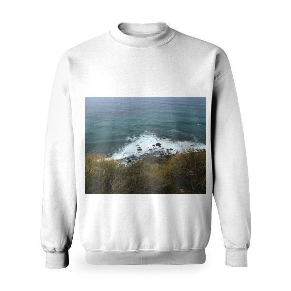 White Froth Waves Of Teal Water Against Green Grass Shore Basic Sweatshirt
