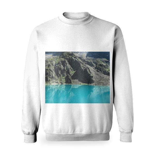 Teal Calm Body Of Water Beside Rock Mountain During Day Time Basic Sweatshirt