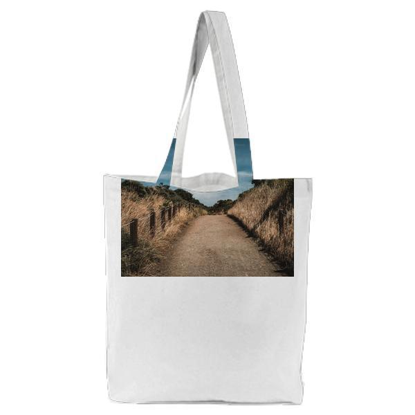 Dried Leaves Beside Empty Pathway During Daytime Tote Bag