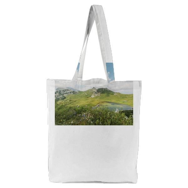 Aerial Photography Of Mountains Under Blue Sky And White Clouds During Daytime Tote Bag