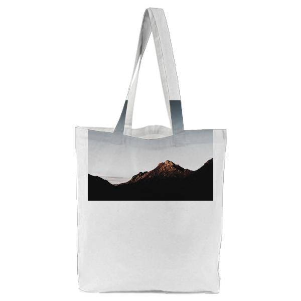 Brown Mountain Ranges Under Blue Sky Tote Bag