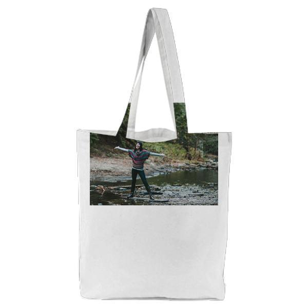 Woman In Black Pants Standing Board Floating River Tote Bag