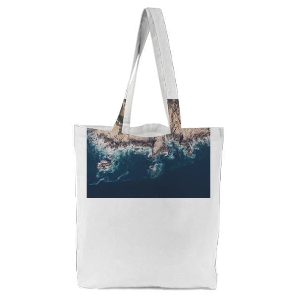 Island Near Sea During Daytime Tote Bag