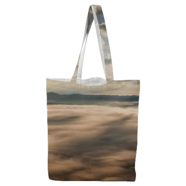 White Clouds With Sun Piercing Through It Tote Bag