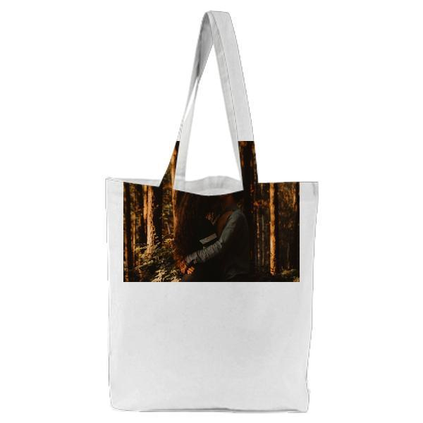 2 People Hugging Near Trees With Orange Sunlight Tote Bag